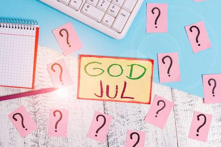 Text sign showing God Jul. Business photo text Merry Christmas Greeting showing for new year happy holidays Writing tools, computer stuff and math book sheet on top of wooden table Stock fotó