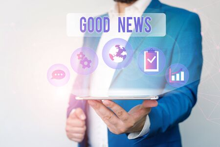 Text sign showing Good News. Business photo text Someone or something positive,encouraging,uplifting,or desirable Male human wear formal work suit presenting presentation using smart device Stockfoto