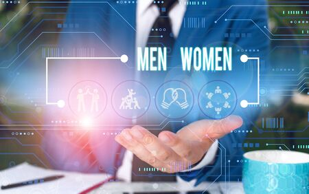 Text sign showing Men Women. Business photo showcasing The state where in a boy or a girl turns to be a mature adult Male human wear formal work suit presenting presentation using smart device