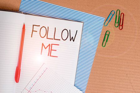 Writing note showing Follow Me. Business concept for Inviting a demonstrating or group to obey your prefered leadership Striped paperboard notebook cardboard office study supplies chart paper Stockfoto