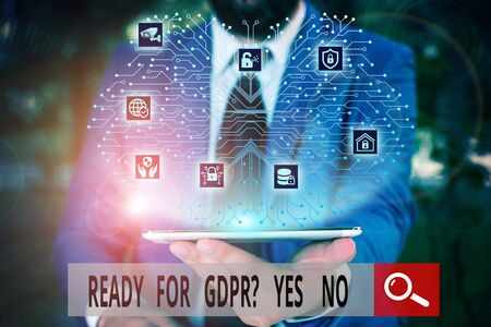 Conceptual hand writing showing Ready For Gdpr Question Yes No. Concept meaning Readiness General Data Protection Regulation Male wear formal work suit presenting presentation smart device