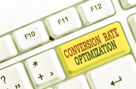 Conceptual hand writing showing Conversion Rate Optimization. Concept meaning system for increasing percentage of visitors White pc keyboard with note paper above the white background