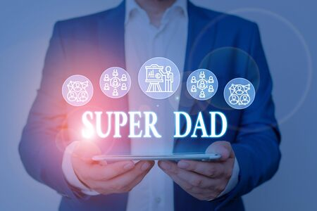 Writing note showing Super Dad. Business concept for Children idol and super hero an inspiration to look upon to Male wear formal work suit presenting presentation smart device Reklamní fotografie
