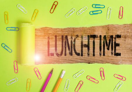Conceptual hand writing showing Lunchtime. Concept meaning Meal in the middle of the day after breakfast and before dinner