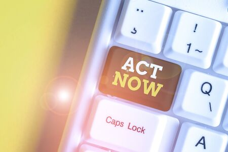 Text sign showing Act Now. Business photo text Having fast response Asking someone to do action Dont delay White pc keyboard with empty note paper above white background key copy space