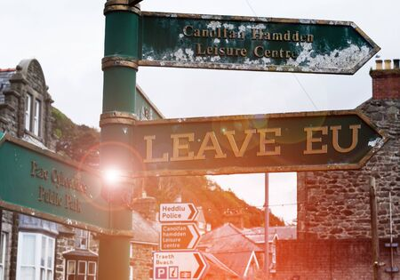 Handwriting text Leave Eu. Conceptual photo An act of a demonstrating to leave a country that belongs to Europe Advertisement concept with empty copy space on the road sign