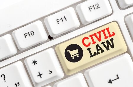 Text sign showing Civil Law. Business photo text Law concerned with private relations between members of community White pc keyboard with empty note paper above white background key copy space