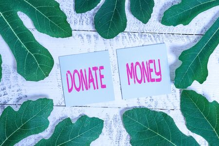 Handwriting text Donate Money. Conceptual photo to give money or goods to help a demonstrating or organization Stockfoto