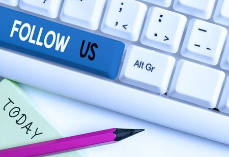 Writing note showing Follow Us. Business concept for Act of demonstrating to invite an individual or group to join his company White pc keyboard with note paper above the white background