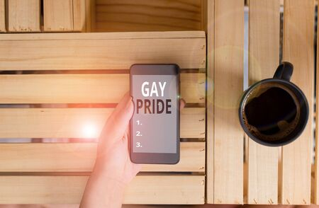 Handwriting text Gay Pride. Conceptual photo Dignity of an idividual that belongs to either a analysis or woanalysis woman computer smartphone drink mug office supplies technological devices Imagens