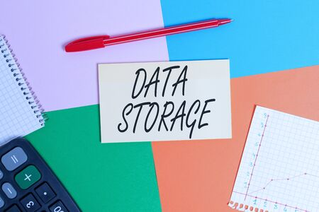 Handwriting text Data Storage. Conceptual photo the act of archiving data in electromagnetic or other forms Office appliance colorful square desk study supplies empty paper sticker