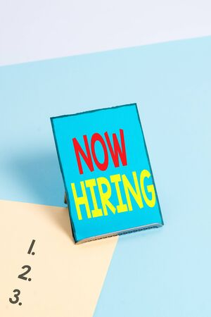 Writing note showing Now Hiring. Business concept for announcing that certain company seeking for new talents