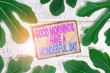 Writing note showing Good Morning And Have A Wonderful Day. Business concept for greeting someone in start of the day