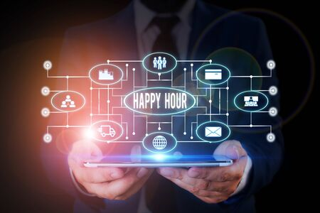 Handwriting text writing Happy Hour. Conceptual photo Spending time for activities that makes you relax for a while Male human wear formal work suit presenting presentation using smart device Reklamní fotografie