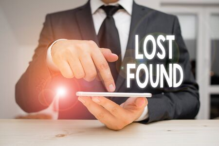 Writing note showing Lost Found. Business concept for Things that are left behind and may retrieve to the owner Фото со стока