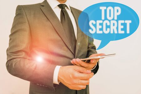 Writing note showing Top Secret. Business concept for telling someone important data or information that he cant tell