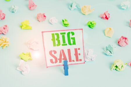 Word writing text Big Sale. Business photo showcasing putting products on high discount Great price Black Friday Colored crumpled papers empty reminder blue floor background clothespin