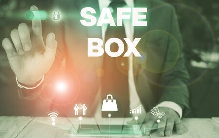 Conceptual hand writing showing Safe Box. Concept meaning A small structure where you can keep important or valuable things Male wear formal suit presenting presentation smart device