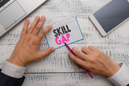 Writing note showing Skill Gap. Business concept for Refering to a demonstrating s is weakness or limitation of knowlege Reklamní fotografie