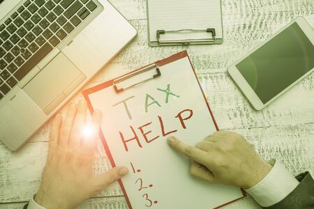 Conceptual hand writing showing Tax Help. Concept meaning Assistance from the compulsory contribution to the state revenue