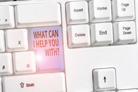 Handwriting text What Can I Help You With Question. Conceptual photo Offering assistance Experts advice ideas White pc keyboard with empty note paper above white background key copy space Banque d'images