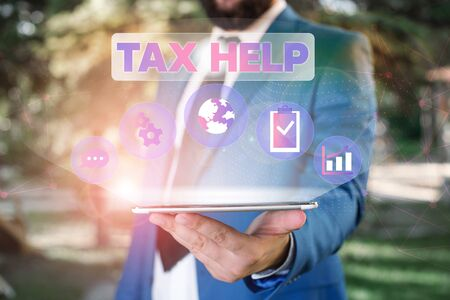 Text sign showing Tax Help. Business photo showcasing Assistance from the compulsory contribution to the state revenue Male human wear formal work suit presenting presentation using smart device