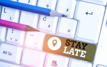 Handwriting text Stay Late. Conceptual photo A routine in which a demonstrating goes to somewhere out of time White pc keyboard with empty note paper above white background key copy space
