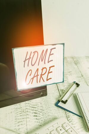 Writing note showing Home Care. Business concept for Place where showing can get the best service of comfort rendered Note paper taped to black computer screen near keyboard and stationary
