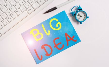 Writing note showing Big Idea. Business concept for Having great creative innovation solution or way of thinking Flat lay above empty note paper on the pc keyboard pencils and clock
