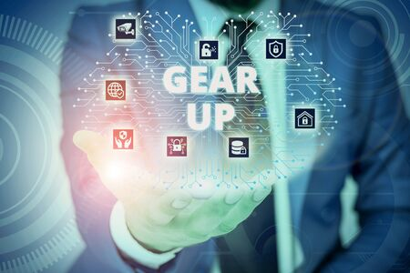 Conceptual hand writing showing Gear Up. Concept meaning Asking someone to put his clothes or suit on Getting ready fast Male wear formal suit presenting presentation smart device