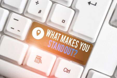 Word writing text What Makes You Stand Out Question. Business photo showcasing asking someone about his qualities White pc keyboard with empty note paper above white background key copy space Фото со стока