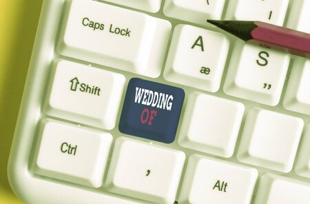 Text sign showing Wedding Of. Business photo text announcing that analysis and woanalysis now as married couple forever White pc keyboard with empty note paper above white background key copy space Stock Photo