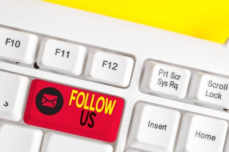 Text sign showing Follow Us. Business photo text Act of demonstrating to invite an individual or group to join his company White pc keyboard with empty note paper above white background key copy space Stockfoto