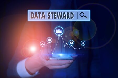 Word writing text Data Steward. Business photo showcasing responsible for utilizing an organization s is data governance Woman wear formal work suit presenting presentation using smart device Reklamní fotografie