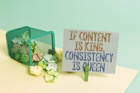 Word writing text If Content Is King Consistency Is Queen. Business photo showcasing Marketing strategies Persuasion Trash bin crumpled paper clothespin empty reminder office supplies tipped Фото со стока