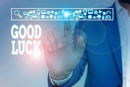 Writing note showing Good Luck. Business concept for A positive fortune or a happy outcome that a demonstrating can have Male wear formal work suit presenting presentation smart device