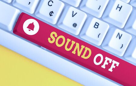 Text sign showing Sound Off. Business photo showcasing To not hear any kind of sensation produced by stimulation White pc keyboard with empty note paper above white background key copy space