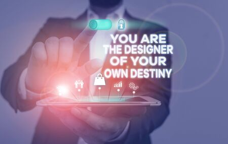 Handwriting text writing You Are The Designer Of Your Own Destiny. Conceptual photo Embrace life Make changes Male human wear formal work suit presenting presentation using smart device
