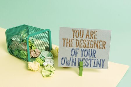Word writing text You Are The Designer Of Your Own Destiny. Business photo showcasing Embrace life Make changes Trash bin crumpled paper clothespin empty reminder office supplies tipped