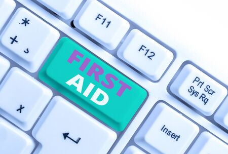 Word writing text First Aid. Business photo showcasing Practise of healing small cuts that no need for medical training White pc keyboard with empty note paper above white background key copy space