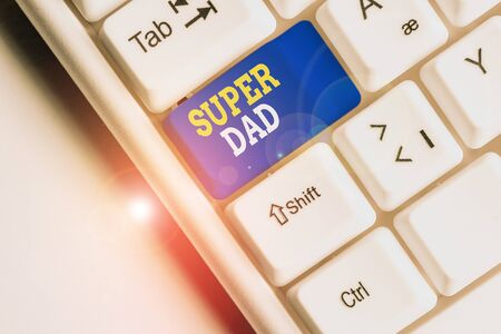 Conceptual hand writing showing Super Dad. Concept meaning Children idol and super hero an inspiration to look upon to White pc keyboard with note paper above the white background