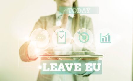 Text sign showing Leave Eu. Business photo text An act of a demonstrating to leave a country that belongs to Europe Female human wear formal work suit presenting presentation use smart device