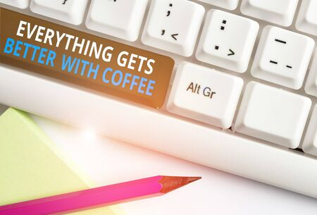 Writing note showing Everything Gets Better With Coffee. Business concept for Have a hot drink when having problems White pc keyboard with note paper above the white background