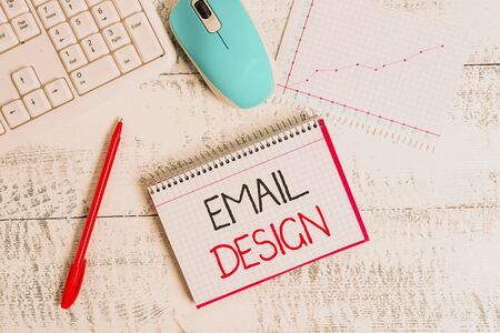 Conceptual hand writing showing Email Design. Concept meaning reusable HTML file that is used to build email campaigns Wood desk office appliance computer equipaments charts paper slot