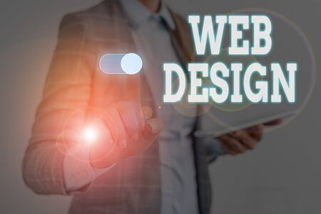 Writing note showing Web Design. Business concept for who is responsible of production and maintenance of websites Woman wear formal work suit presenting presentation using smart device Banco de Imagens