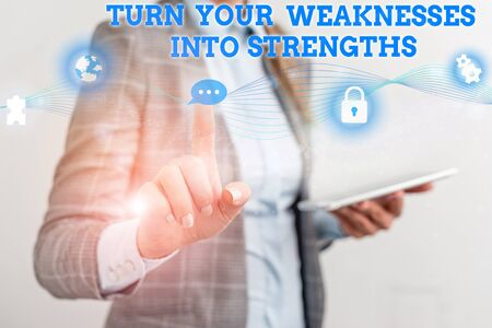 Word writing text Turn Your Weaknesses Into Strengths. Business photo showcasing work on your defects to get raid of them Female human wear formal work suit presenting presentation use smart device Archivio Fotografico - 131102934
