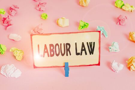 Conceptual hand writing showing Labour Law. Concept meaning Rules implemented by the state between employers and employee Colored crumpled papers empty reminder pink floor clothespin Stock Photo