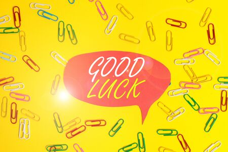 Handwriting text Good Luck. Conceptual photo A positive fortune or a happy outcome that a demonstrating can have Flat lay above empty paper with copy space and colored paper clips Stock Photo