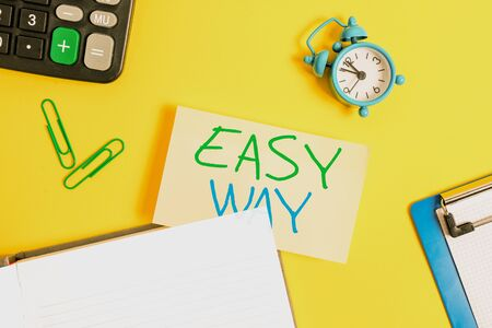 Text sign showing Easy Way. Business photo showcasing making hard decision between two less and more effort method Empty orange paper with copy space on the yellow table Stock fotó