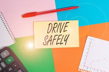 Handwriting text Drive Safely. Conceptual photo you should follow the rules of the road and abide laws Office appliance colorful square desk study supplies empty paper sticker Stock Photo